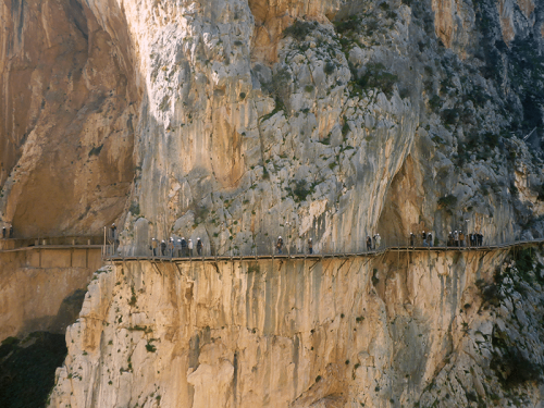 People on El Caminito del Rey watching us climb zeppelin